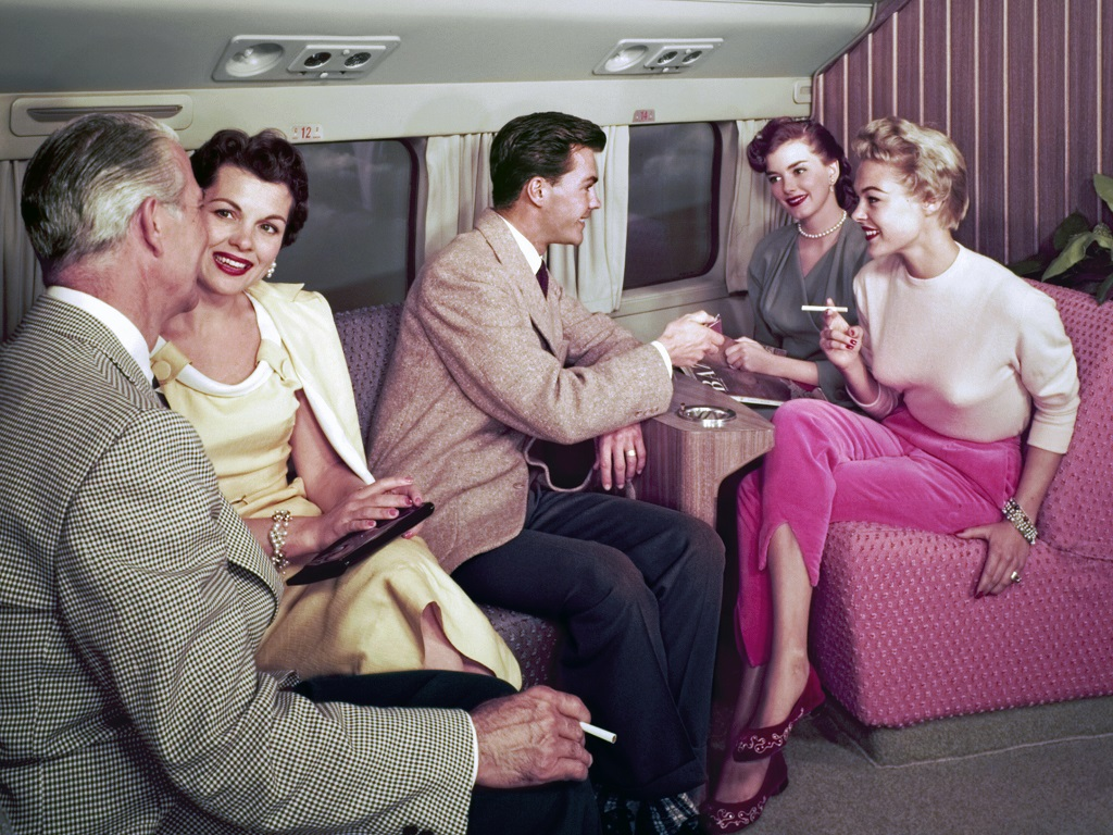 Passengers share a smoke in the aircraft lounge