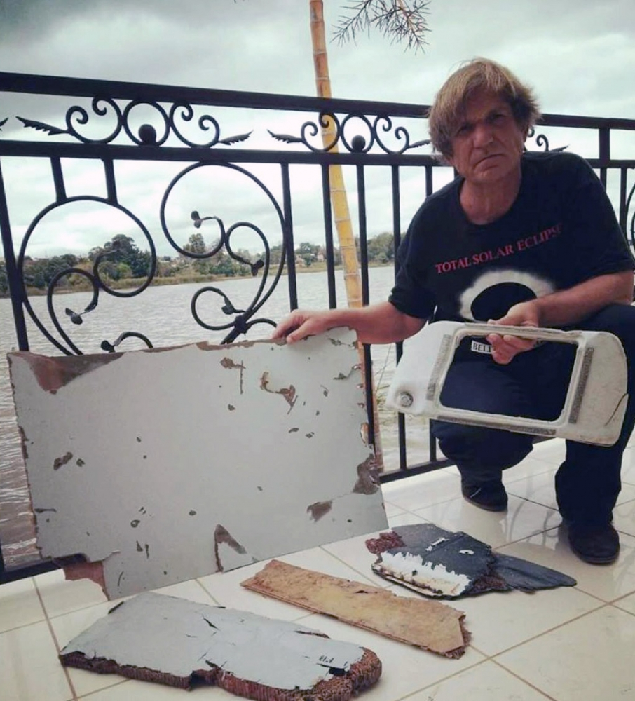 Mr Gibson with some of the MH370 debris