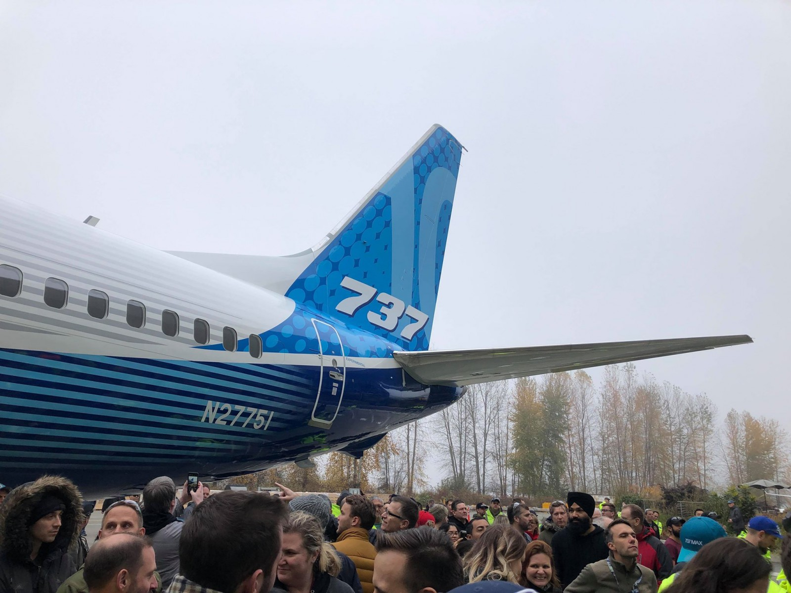 Boeing unveils a new 737 MAX even as grounding drags on