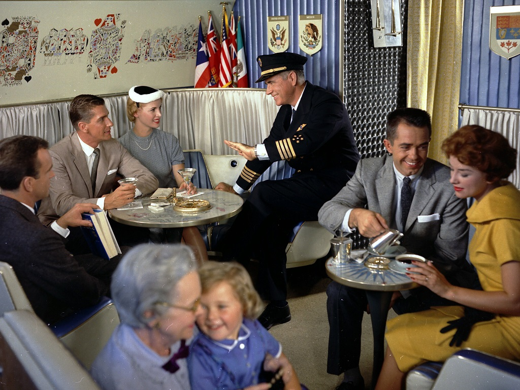 Passengers relax in the aircraft's lounge