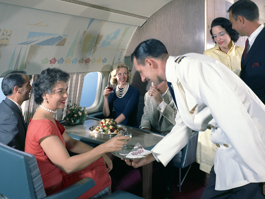 Passengers share a drink in the lounge