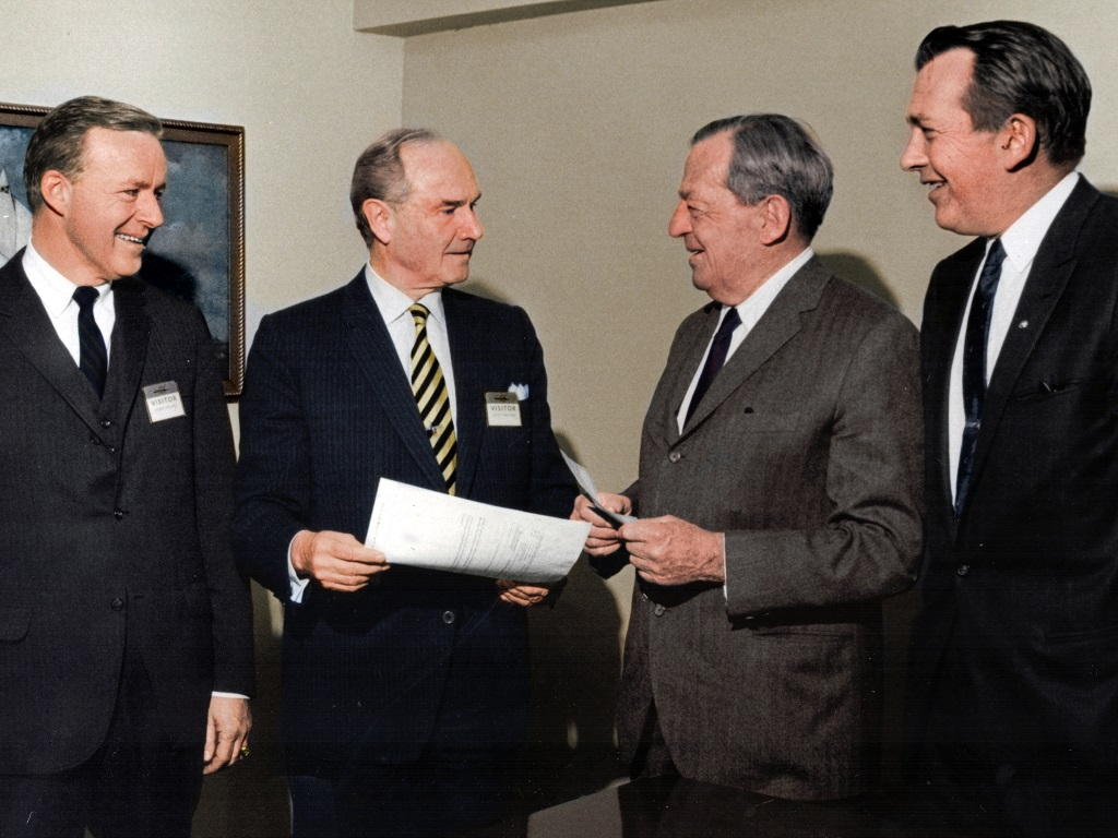 McDonnell and Douglas executives at the signing of the merger in 1967.