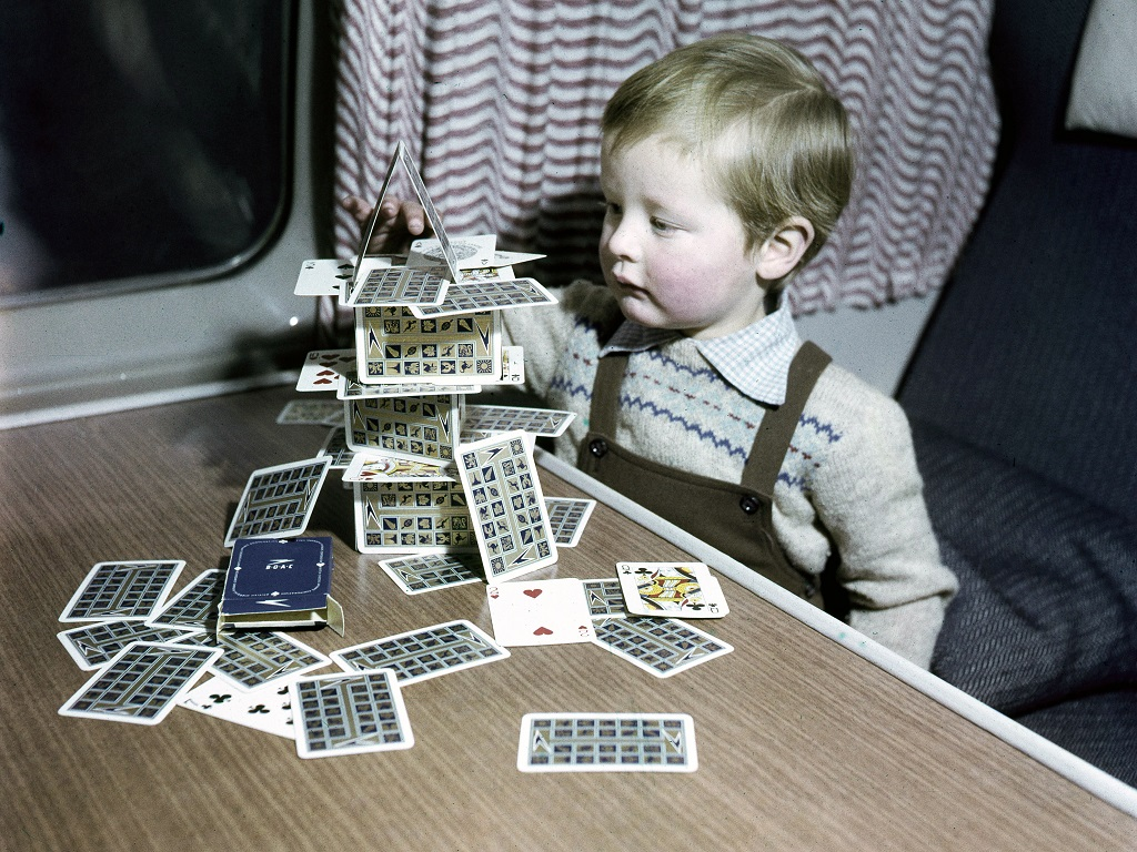 Child building a house of cards
