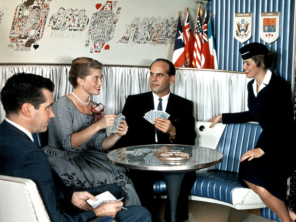 Passengers playing cards in the lounge