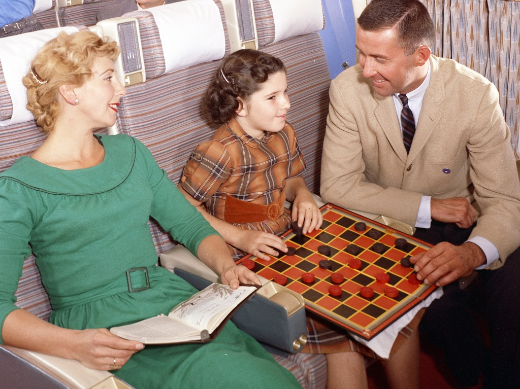 Playing drafts with mum and dad in economy class