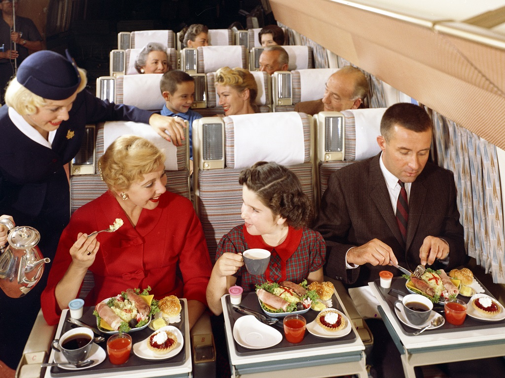 Passengers enjoy an economy meal