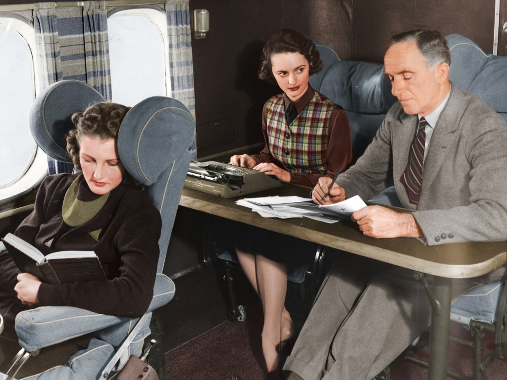 Lady types for her boss on the flying boat.